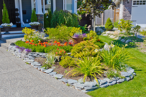 Front yard with a flower bed lined with stones